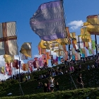 Coloured flags in the wind at a festival