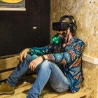 Player wearing mask and VR_glasses in VR-installation 'A breathtaking journey'