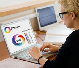 Person using computer with Altmetric